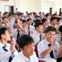 Pyongyang University of Science and Technology students attend a class.   REUTERS