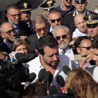 Italian Vice Prime Minister and Minister of the Interior Matteo Salvini receives media attention as he arrives to visit a 'hot spot' in the Sicilian port of Pozzallo, where many of the rescue ships dock disembarking migrants who need to be fingerprinted and otherwise identified as a first step in the process of seeking asylum, Sunday. | ANDREA SCARFO' / ANSA / VIA AP