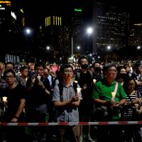 People take part in a candlelight vigil at Victoria Park in Hong Kong on Monday to mark the 29th anniversary of the massacre in Beijing's Tiananmen Square in 1989. | REUTERS