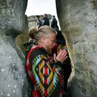 Over 9,000 people gather at Britain's ancient Stonehenge to greet longest day of the year