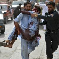 Taliban refuse to extend Afghanistan cease-fire as Islamic State suicide attack kills 18