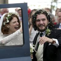 Actors Kit Harington and Rose Leslie leave after their wedding ceremony at Rayne Church, Kirkton of Rayne in Aberdeenshire, Scotland, on Saturday. | AP