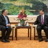 China's President Xi Jinping attends a meeting with U.S. Secretary of State Mike Pompeo at the Great Hall of the People in Beijing on Thursday. | POOL / VIA REUTERS