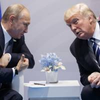 U.S. President Donald Trump meets with Russian President Vladimir Putin at the G20 Summit in Hamburg last July. The Kremlin and the White House announced Thursday that a summit between Putin and Trump will take place in Helsinki on July 16. | AP