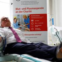 German President Frank-Walter Steinmeier visits Berlin's Center for Transfusion Medicine and donates blood on 'World Blood Donor Day' in Berlin June 13. | REUTERS