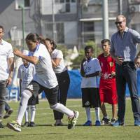 Britain's Prince William watches Jewish and Arab children playing soccer at the Neve Golan Stadium in Jaffa, Israel, Tuesday. The prince is the first member of the British royal family to pay an official visit to Israel. Though the trip is being billed as nonpolitical, the prince is meeting with Israeli and Palestinian leaders and visiting sites at the heart of the century-old conflict. | HEIDI LEVINE / POOL PHOTO / VIA AP