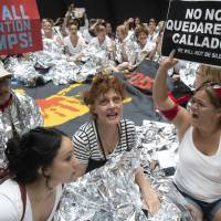 Hundreds of activists, including actress Susan Sarandon (center), challenge the Trump administration's approach to illegal border crossings and separation of children from immigrant parents, in the Hart Senate Office Building on Capitol Hill in Washington Thursday. | AP