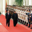 North Korean leader Kim Jong Un walks beside Chinese President Xi Jinping in Beijing on Tuesday.
