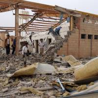 People inspect damage at a Doctors Without Borders medical facility after it was hit by an airstrike in Abss, Yemen, Monday.   REUTERS