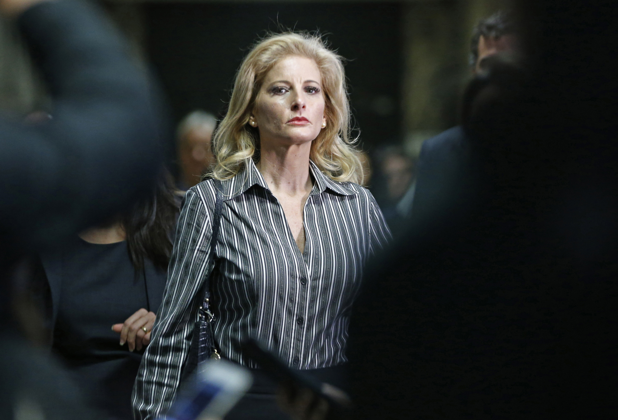 Summer Zervos leaves Manhattan Supreme Court at the conclusion of a hearing in New York in December. On Thursday, the New York Court of Appeals turned down President Donald Trump's latest bid to delay a defamation suit filed by the former contestant on 'The Apprentice,' who accused him of unwanted groping and kissing. Zervos says Trump made unwanted advances in 2007, then defamed her by saying she lied. | AP
