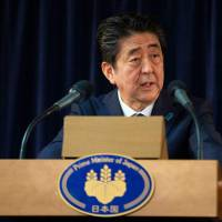 Prime Minister Shinzo Abe addresses a press conference at the conclusion of the G7 Summit in La Malbaie, Canada on Saturday. | AFP-JIJI