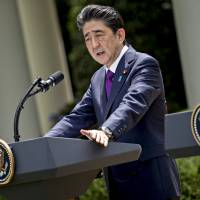Shinzo Abe, Japan's prime minister, speaks during a news conference with U.S. President Donald Trump in the Rose Garden of the White House in Washington on Thursday. Abe has plenty to worry about ahead of Trump's meeting with Kim Jong Un next week, including the prospect of a deal that undermines Japan's six-decade security alliance with the U.S. and leaves the island nation vulnerable to attack.   BLOOMBERG