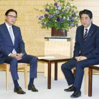Prime Minister Shinzo Abe meets with Keiji Furuya, chairman of a nonpartisan group of lawmakers pursuing the abduction issue, at the Prime Minister's Office on Friday. | KYODO