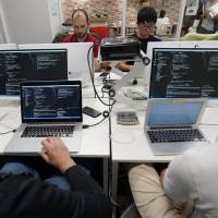 Students attend Code Chrysalis, a software-coding boot camp, at a basement room in Tokyo on May 23.   REUTERS