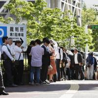 People line up at the Chiba District Court on Monday for tickets to the opening of a man indicted for murdering a 9-year-old Vietnamese girl in March last year. | KYODO