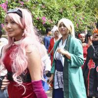 Fans of cosplay gather for an event in Bengaluru, India, in March. | KYODO