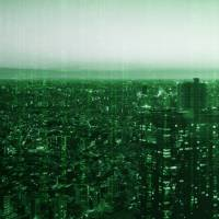 Tokyo is depicted with a green computer coding motif reminiscent of 'The Matrix.' There is hope the development of a prediction system based on big data and artificial intelligence will be effective in preventing street crime in Japan. | GETTY IMAGES