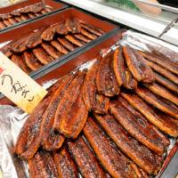According to Greenpeace Japan, at least 2.7 tons of cooked eel was thrown away by retailers last year after the traditional summer promotion campaign. | KYODO