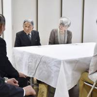 The Imperial Couple on Saturday listen to residents of a publicly funded apartment complex in Iwaki, Fukushima Prefecture, that was built for those displaced by the March 2011 quake, tsunami and nuclear crisis. | KYODO