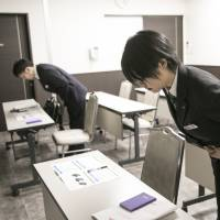 Employees practice their bows during a business etiquette class at the Tear Corp. headquarters in Nagoya. Tear is a chain of discount funeral homes known for transparent pricing. | BLOOMBERG