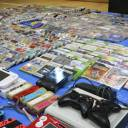 Video game consoles and game titles that police confiscated from bars in Kyoto and Kobe are seen at the Nakagyo Police Station in Kyoto on Wednesday.