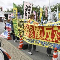 People gather in front of the Genkai facility on Saturday morning to protest against the restart of the No. 4 unit. | KYODO