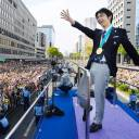Figure skating superstar Yuzuru Hanyu waves to the crowd during a victory parade in Sendai in April.