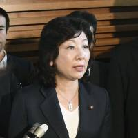 Seiko Noda, minister in charge of women's empowerment, answers questions from reporters at the Prime Minister's Office on Tuesday. | KYODO