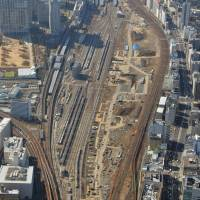 The site for a new station on Tokyo's Yamanote Line is seen in this aerial photo taken in March last year. East Japan Railway Co. is asking the public to name the station, which is to be opened in the spring of 2020. | KYODO