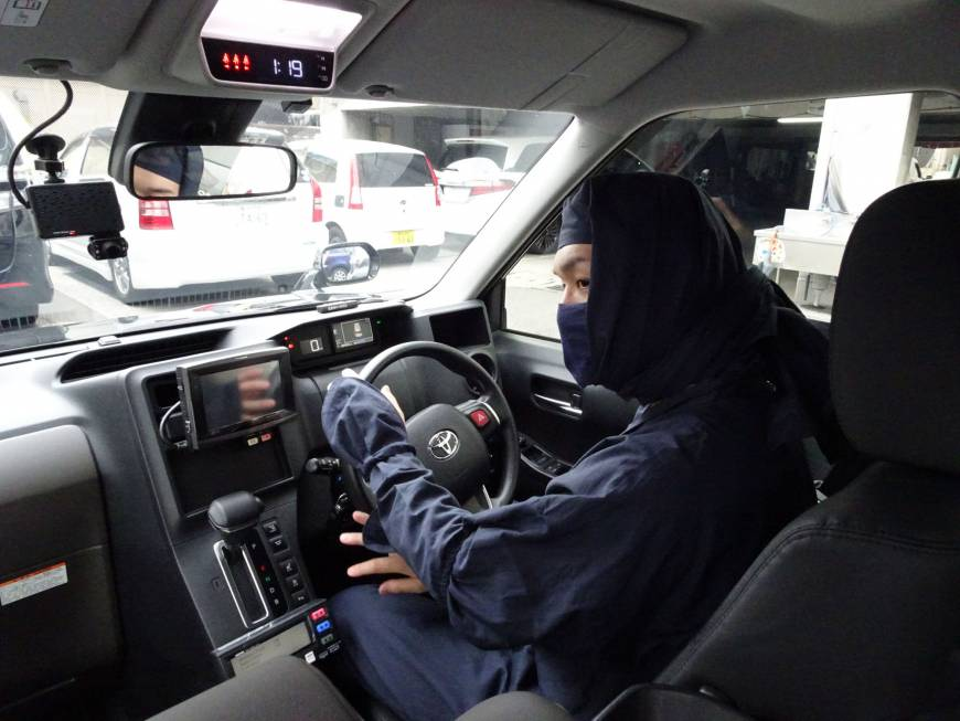 A Sanwa Koutsu Group taxi driver sports a ninja outfit on Monday in Yokohama as part of the firm's unique effort to attract new customers.   KANTARO KOMIYA