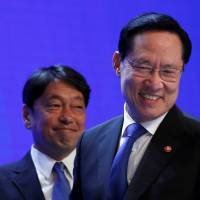South Korean Defense Minister Song Young-moo (right) arrives to speak next to his Japanese counterpart, Itsunori Onodera, at the IISS Shangri-la Dialogue in Singapore on Saturday. | REUTERS