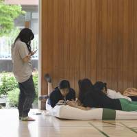People pile into shelters in quake-hit Osaka Prefecture as rains stir landslide fears