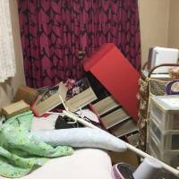 A provided photo shows pieces of furniture falling in a room in Takatsuki, Osaka Prefecture, Monday morning after the Kansai area was hit by a major earthquake. | KYODO