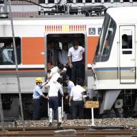 People get off a train in Osaka's Kita Ward Monday morning after West Japan Railway Co. and other railways suspended operations following a major earthquake. | KYODO