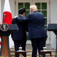 U.S. President Donald Trump and Prime Minister Shinzo Abe leave after holding a joint news conference in the Rose Garden of the White House on Thursday. | REUTERS