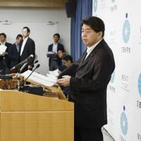 Yoshimasa Hayashi, science minister, speaks at a news conference at the ministry in Tokyo on Tuesday.   KYODO