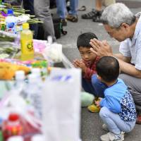 Takatsuki residents mourn death of 9-year-old girl, as cleanup in quake-hit Kansai continues