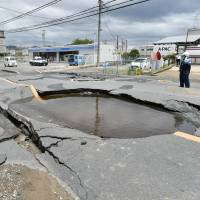 A burst water pipe caused a sinkhole in Takatsuki, Osaka Prefecture, after a powerful earthquake hit the prefecture and its vicinity on June 18. | KYODO