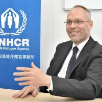 Dirk Hebecker, head of the Tokyo office of the United Nations High Commissioner for Refugees, discusses an awareness-raising event at Shibuya Station during an interview at the UNHCR office in Minato Ward on June 13. | YOSHIAKI MIURA