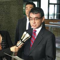 Foreign Minister Taro Kono speaks to reporters at the ministry Wednesday.   KYODO