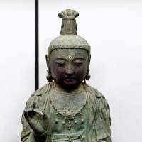 An ancient Buddhist statue stolen from a Japanese temple in 2012 is shown in January 2013 in Daejon, South Korea. | YONHAP / VIA KYODO
