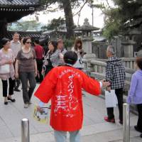 Tourists visit Zentsuji temple in Zentsuji, Kagawa Prefecture. According to the latest white paper on tourism released Tuesday, the number of foreign visitors has particularly increased in rural areas such as Kagawa, Saga and Aomori prefectures. | KYODO