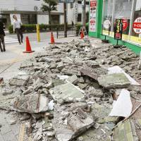A wall of a building in Ibaraki, Osaka Prefecture, is seen collapsed Monday following a big earthquake that hit the Kansai region. | KYODO