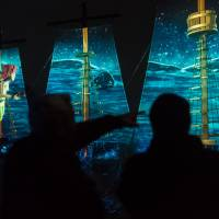 Visitors take part in Moment Factory's multimedia experience on Iojima island in Nagasaki Prefecture. | COURTESY OF MOMENT FACTORY