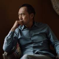 Room with a view: Ken Watanabe looks out the window of a hotel in London in March. | ANASTASIJA JE