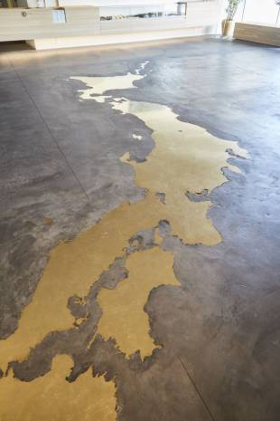A brass map of Japan sits on the floor of Nousaku in Takaoka, Toyama Prefecture.
