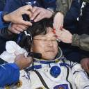 Long time gone: Astronaut Norishige Kanai is tended to upon his return to Earth.