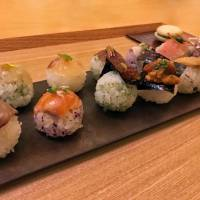 Elegant creations: Each temari-zushi comes with its own topping, from ika (squid) and sweet chili, to cured duck and yuzu citrus. | J.J. O'DONOGHUE
