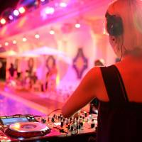 A DJ prepares to play at a night pool event at Tokyo's New Otani hotel. | © 2017 CREATIVE PROJECT, INC.