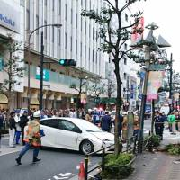 Age gap: An 85-year-old driver was arrested after ramming into pedestrians in front of a department store in Tokyo in 2017. | KYODO